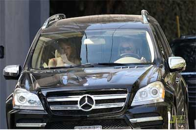 Reece Witherspoon driving her Mercedes Benz GL 350