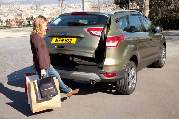 The hands-free tailgate operates with a simple kicking motion