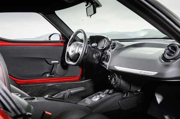 Bucket seats and aluminium pedals convey the real purpose of this car